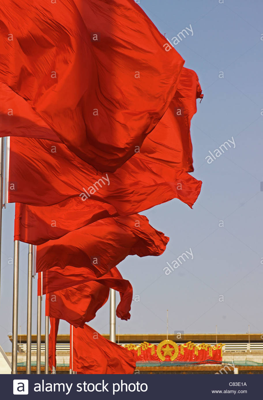 Red flags waving in wind - Stock Image