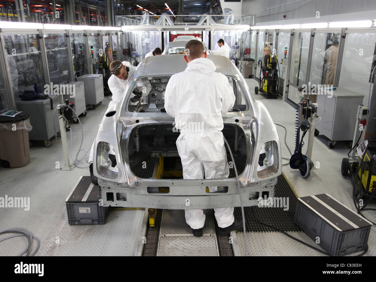 Employees work on a Mulsanne Bentley motor car at the company's factory in Crewe, U.K. - Stock Image