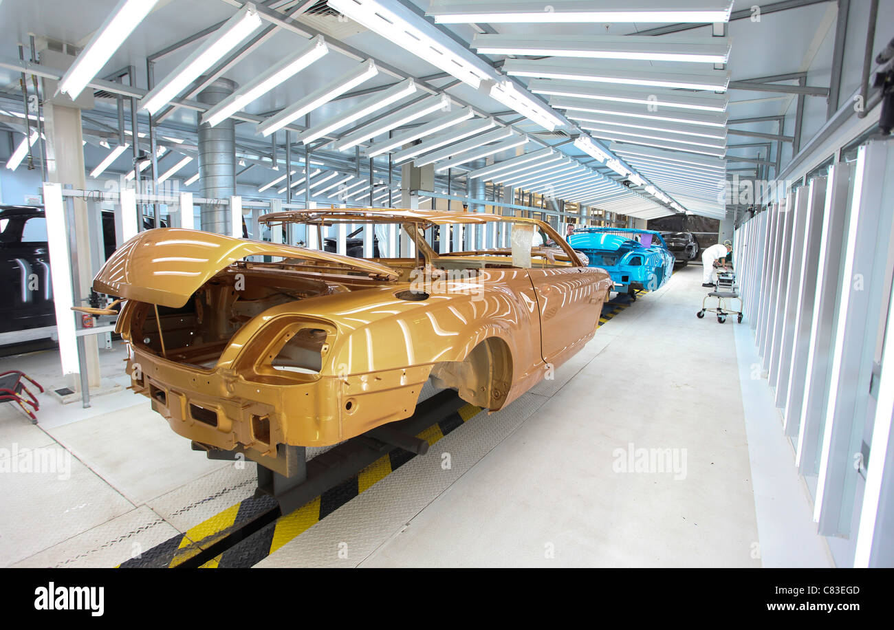 Painted Bentley GT Continental motor car body shells at the company's factory in Crewe, U.K. - Stock Image