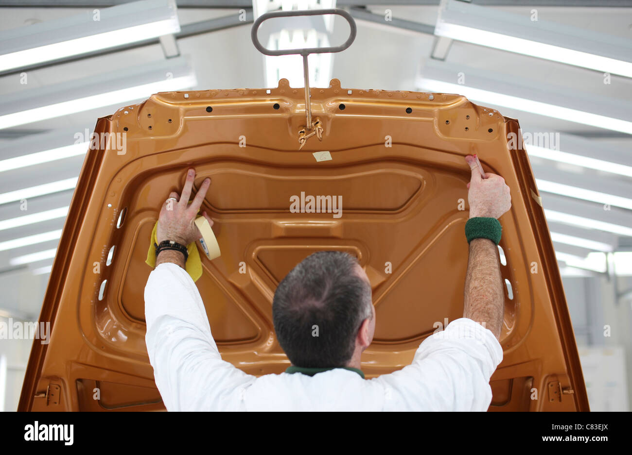 Painted Bentley motor car body shells are inspected at the company's factory in Crewe, U.K. - Stock Image