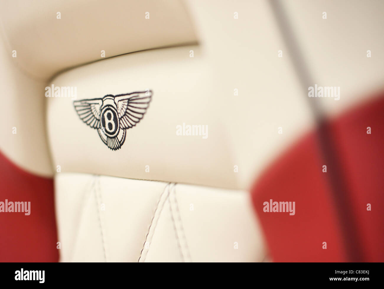 Embroidered Bentley motor car seats are seen at the company's factory in Crewe, U.K. - Stock Image