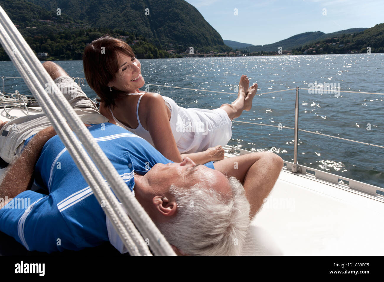 Older couple relaxing on sailboat - Stock Image