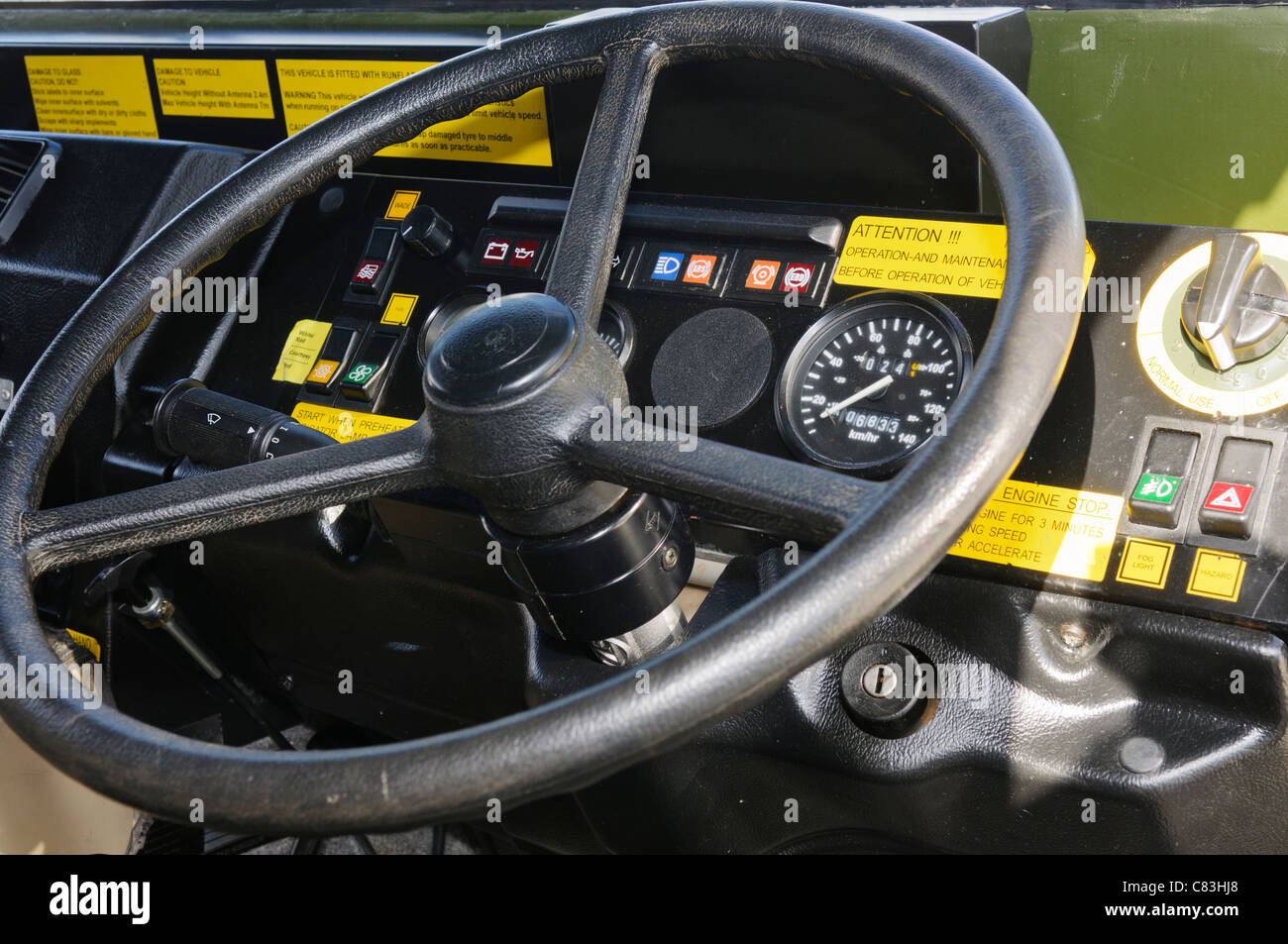 Drivers steering wheel and dashboard of a Vector Armoured Personnel Carrier - Stock Image