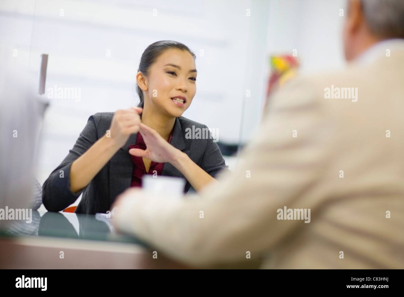 Businesswoman talking in conference - Stock Image