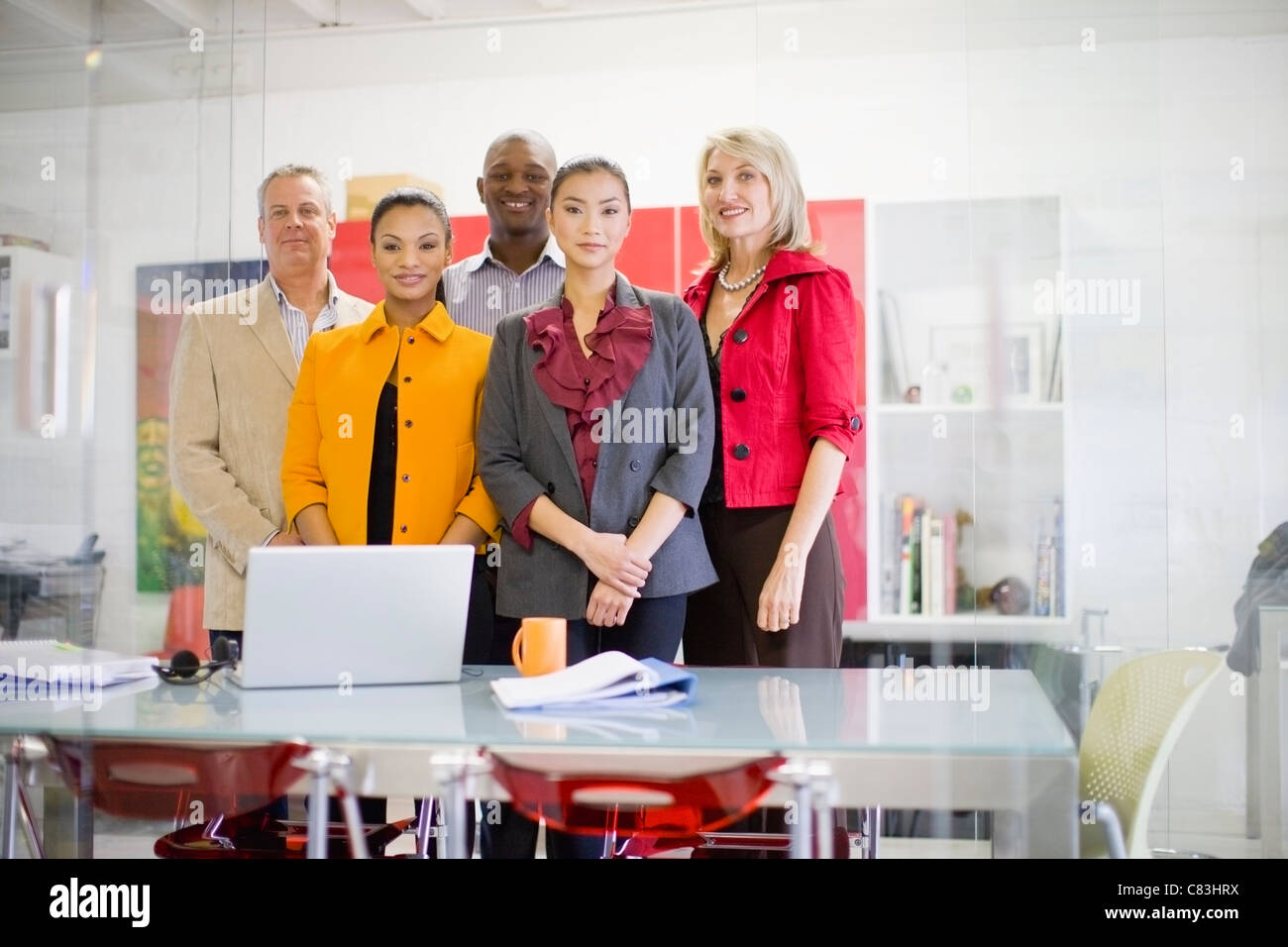 Business people smiling in office - Stock Image