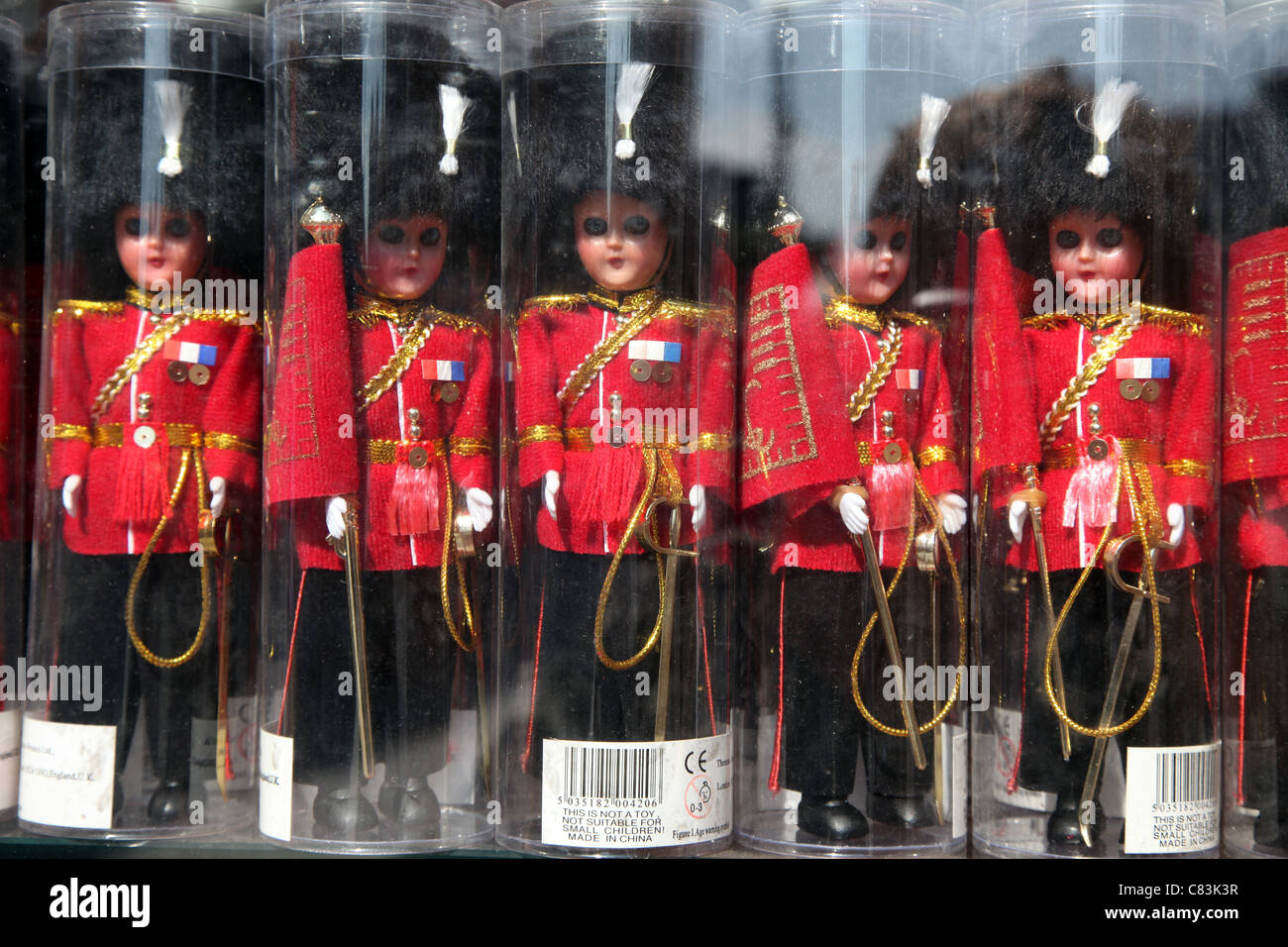 Miniature Beefeaters for sale in a tourist shop - Stock Image