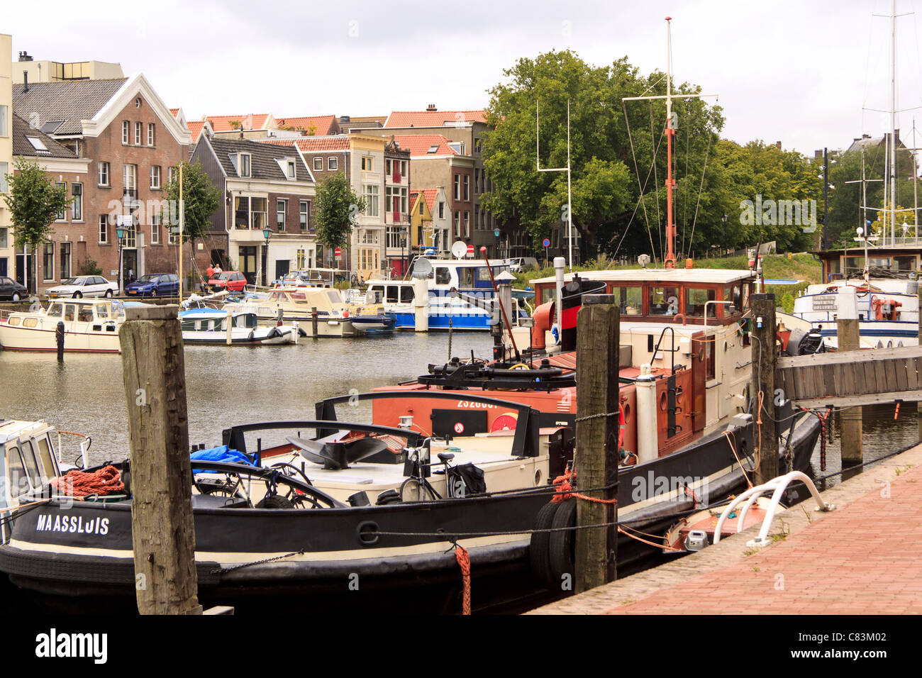 Wooden Dutch barges in the harbour at Delfshaven, Rotterdam, Netherlands Stock Photo