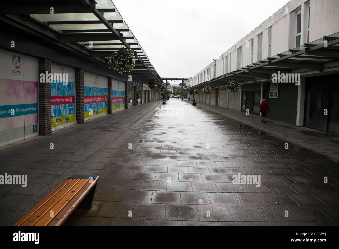 Dumbarton sparse shopping centre most shops boarded up in mid week sad depressing place - Stock Image