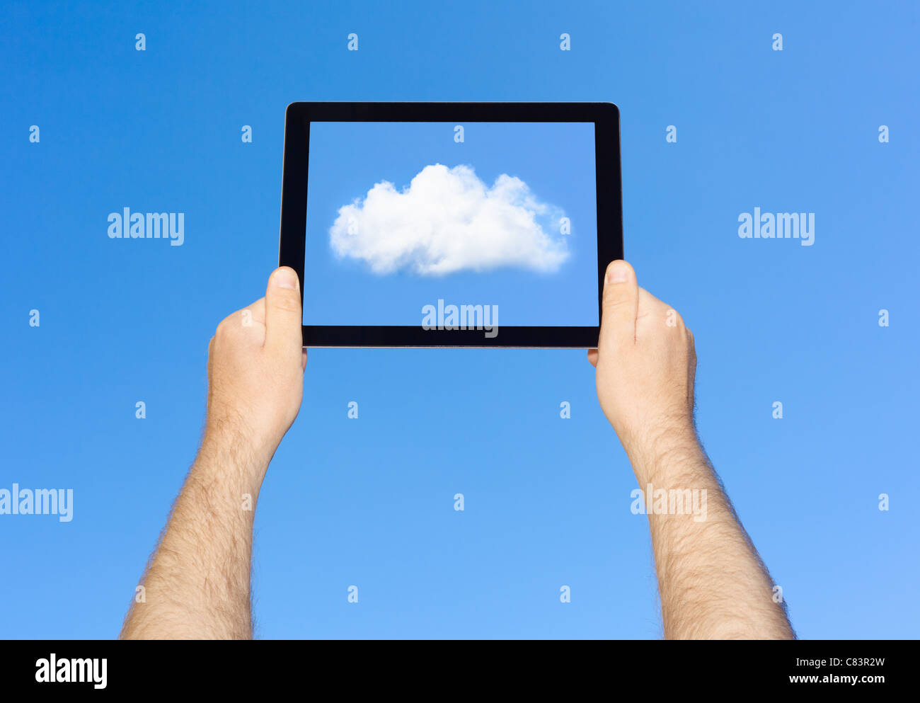 Man viewing cloud on tablet computer - Stock Image