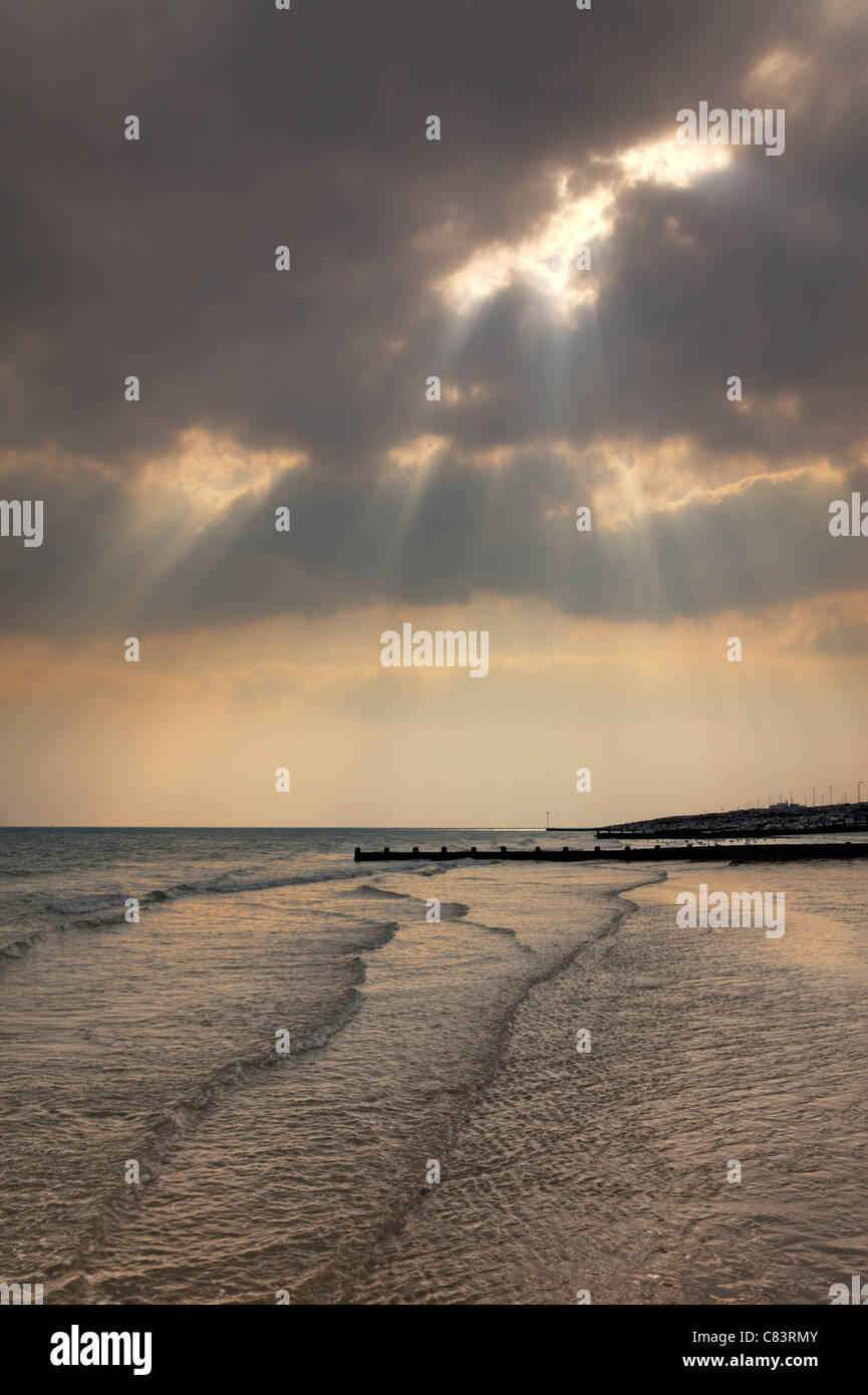Sunrays through the cloud, Worthing coast, West Sussex - Stock Image