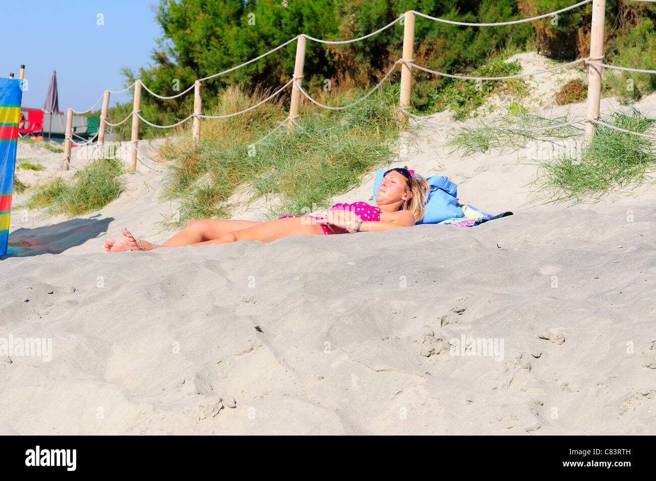 Girl sunbathing  on West Wittering's beach on 'the hottest  day of the year'-surprisingly on Autumns October - Stock Image