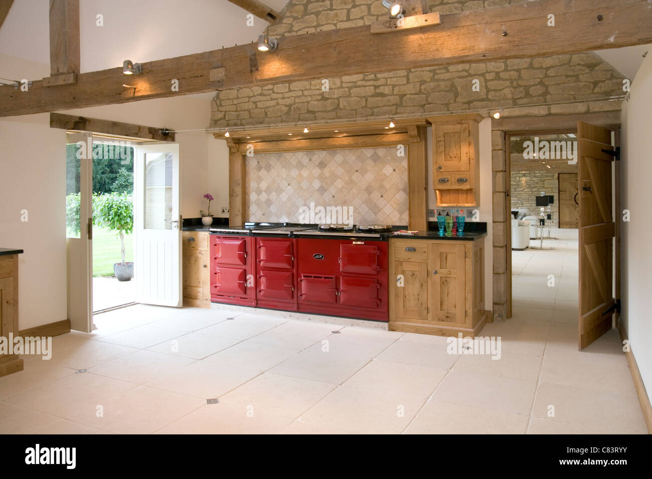 Brand New Contemporary Upmarket Fitted Kitchen With Aga Cooker Stock Photo Alamy