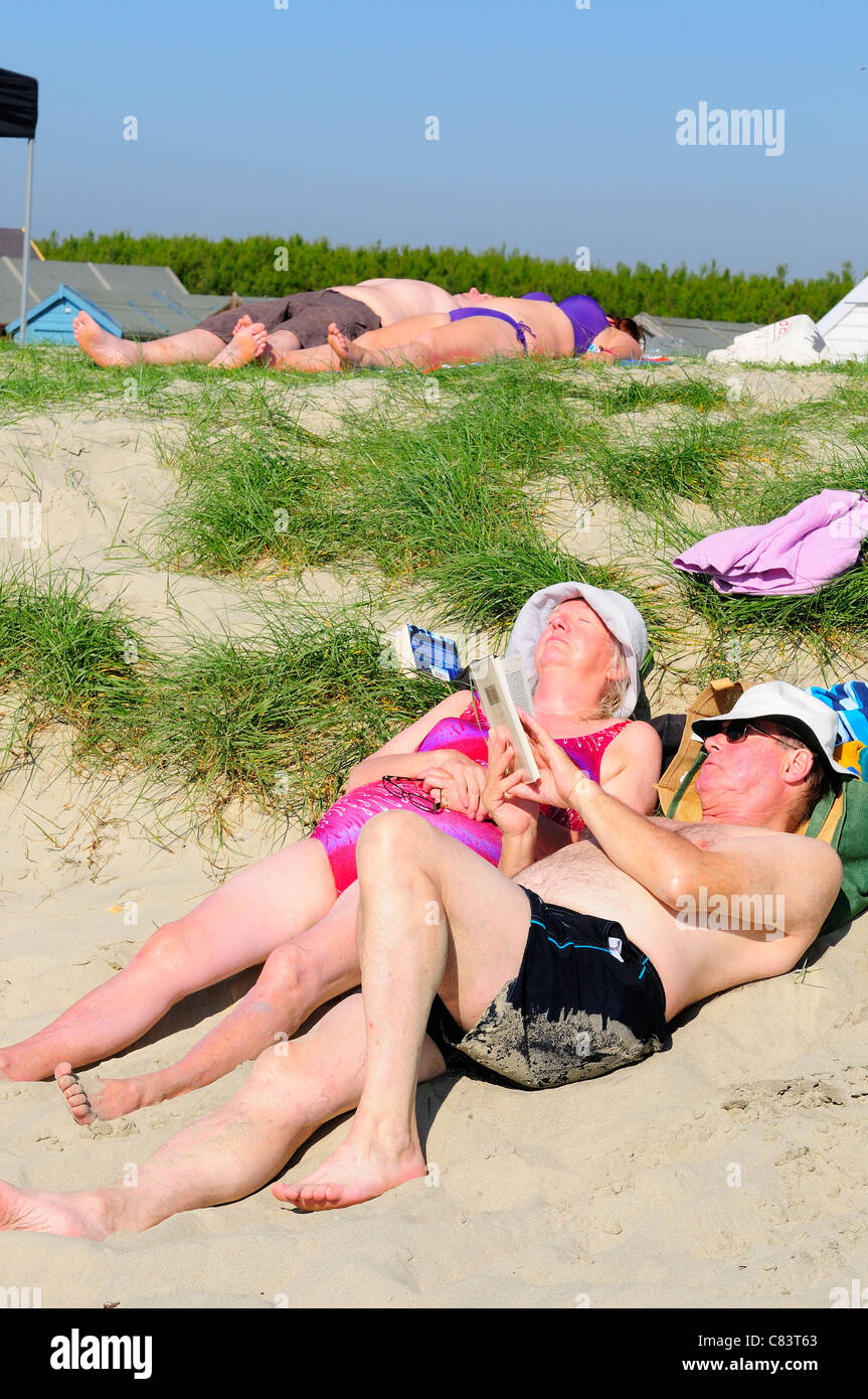 Couples relaxing on West Wittering's beach on 'the hottest  day of the year'-surprisingly on Autumns October - Stock Image