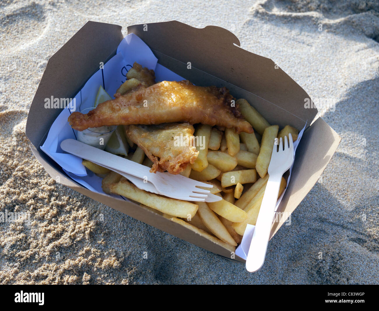 Fish And Chips on the beach. - Stock Image
