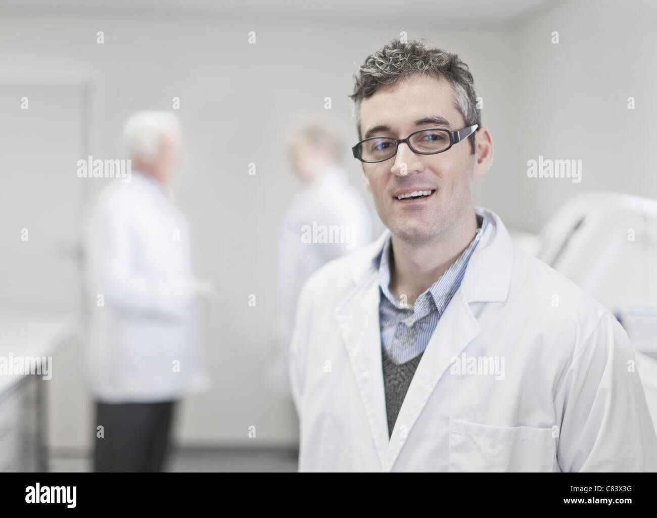 Scientist standing in pathology lab - Stock Image