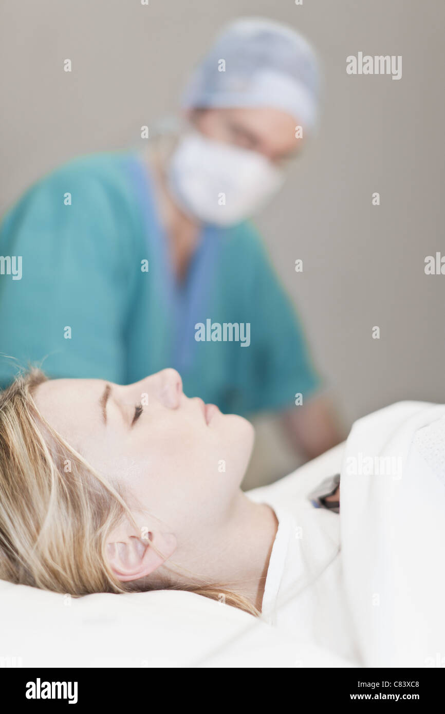 Patient unconscious in operating room - Stock Image