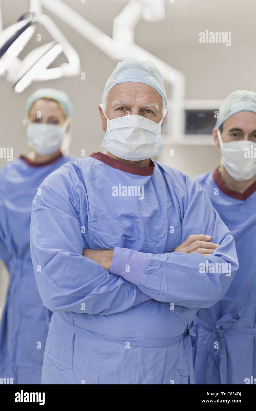 Team of doctors in operating room - Stock Image