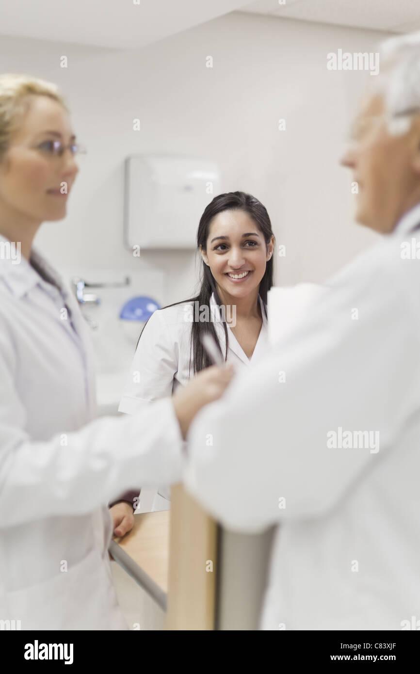 Doctors talking in hospital - Stock Image