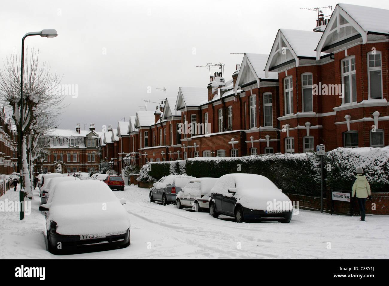 Snowy London street in Willesden Green - Stock Image