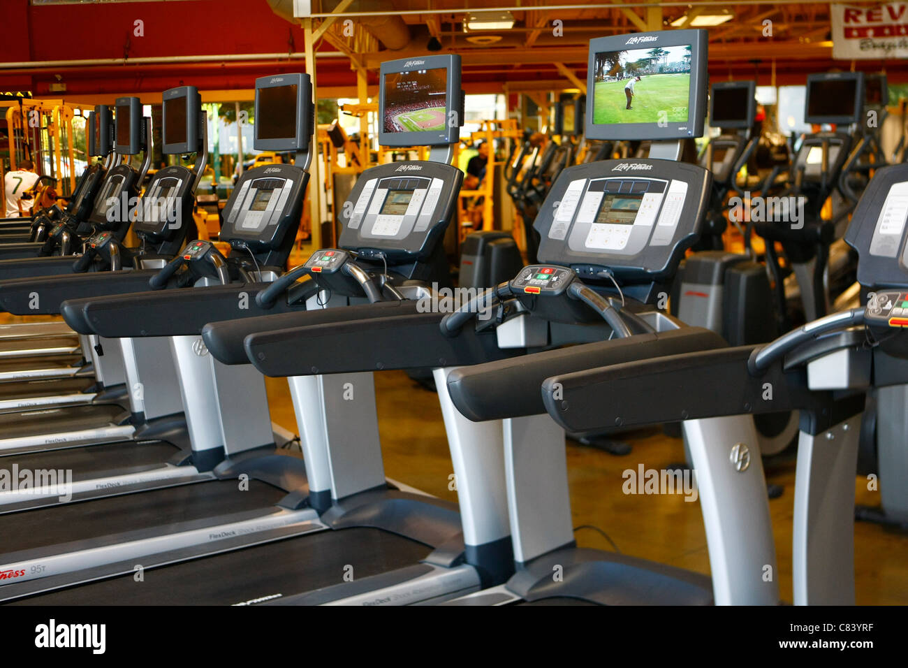 treadmills and cadio exercise equipment in a gym - Stock Image