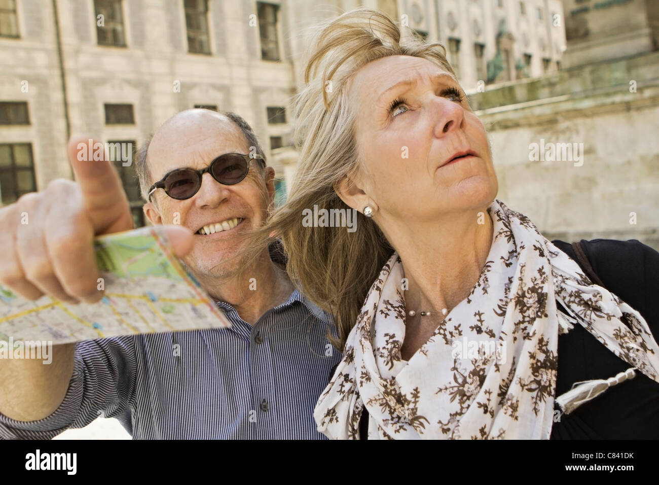 Older couple using city map Stock Photo