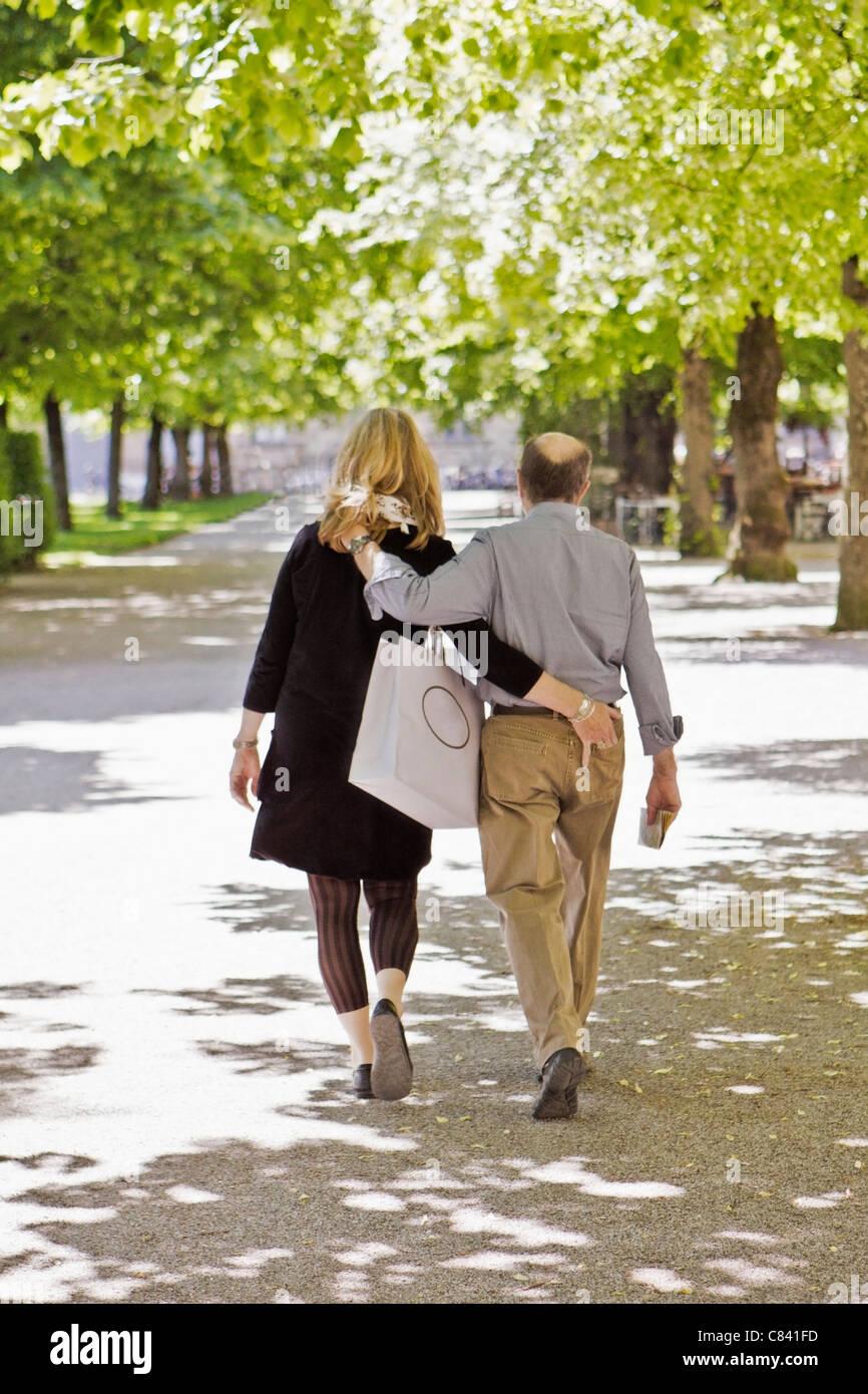 Older couple walking in park together - Stock Image
