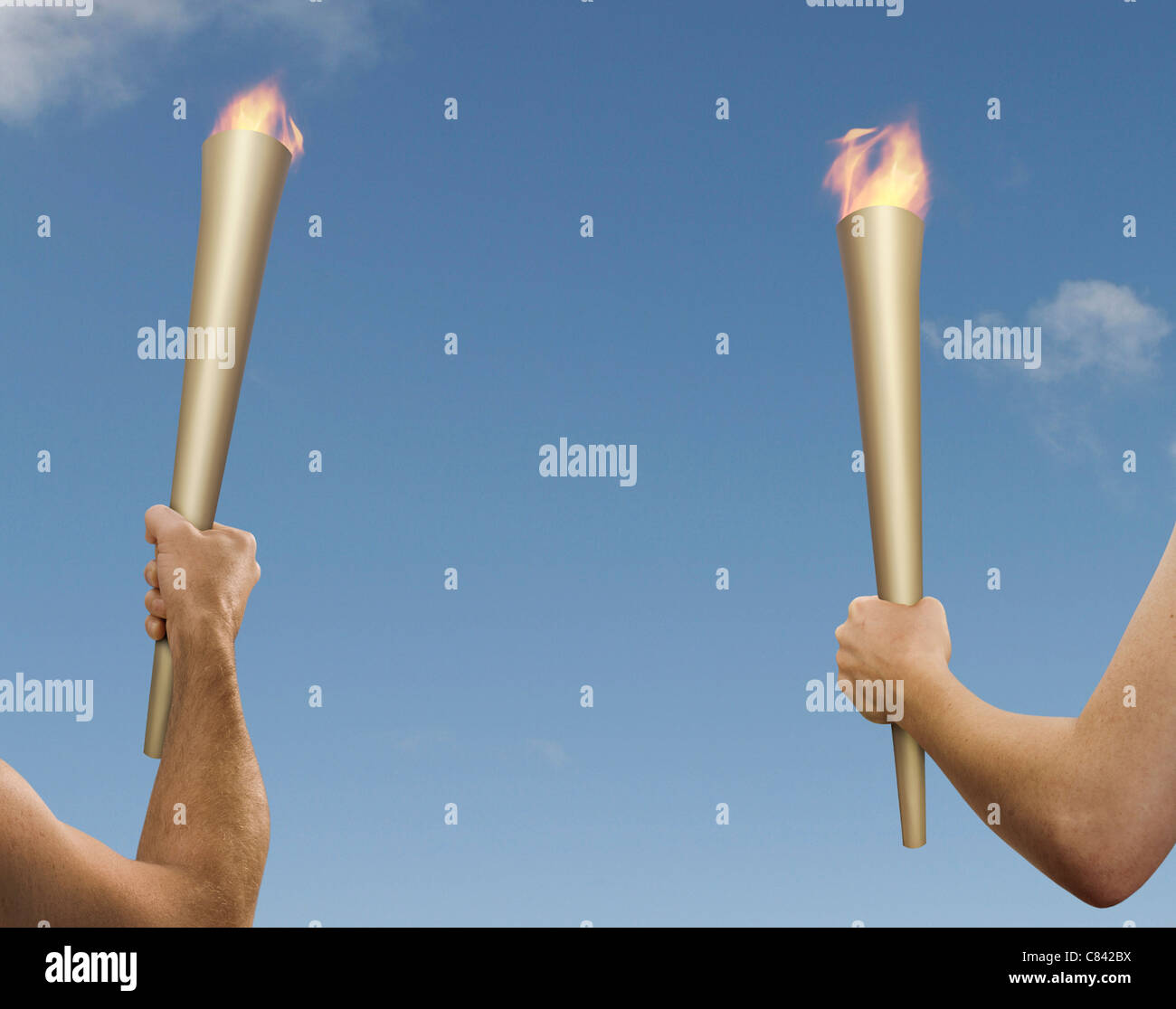 Hands holding flaming batons Stock Photo