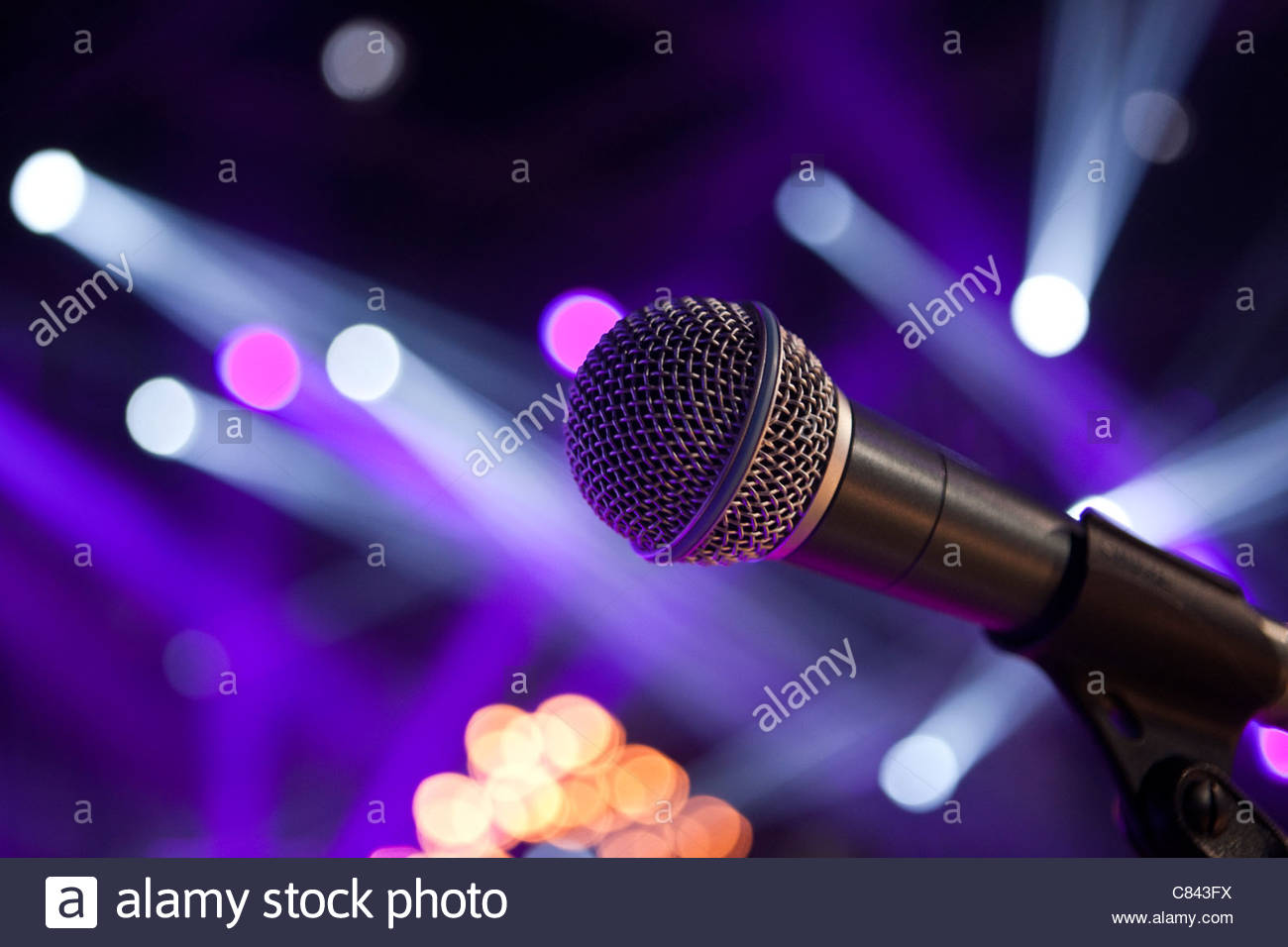 Close up of microphone in concert hall - Stock Image