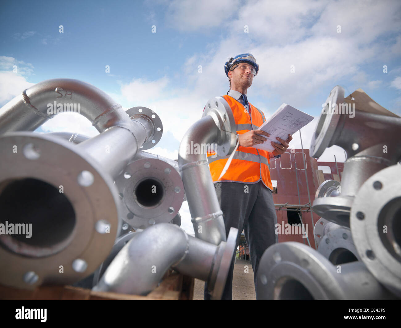 Businessman on shipbuilding site - Stock Image