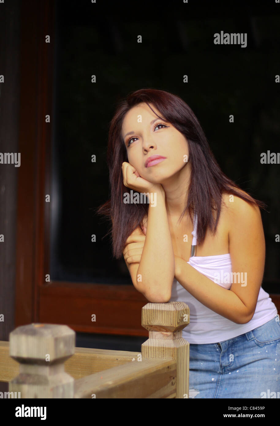 a lovely young lady with her head on her hand - Stock Image