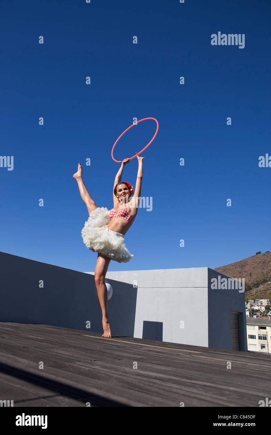Woman in tutu dancing with hula hoop Stock Photo