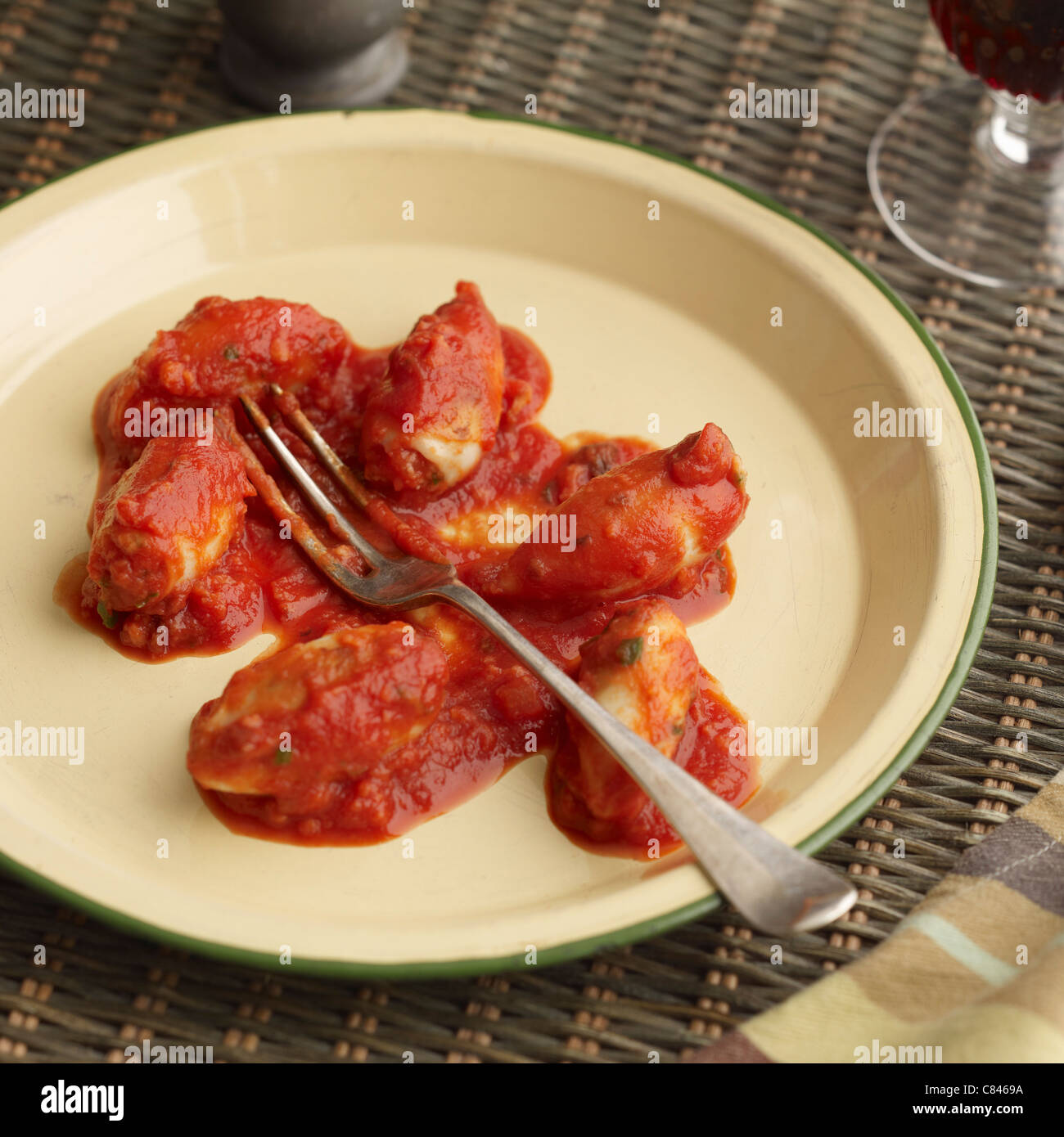 Plate of stuffed squid provencal - Stock Image