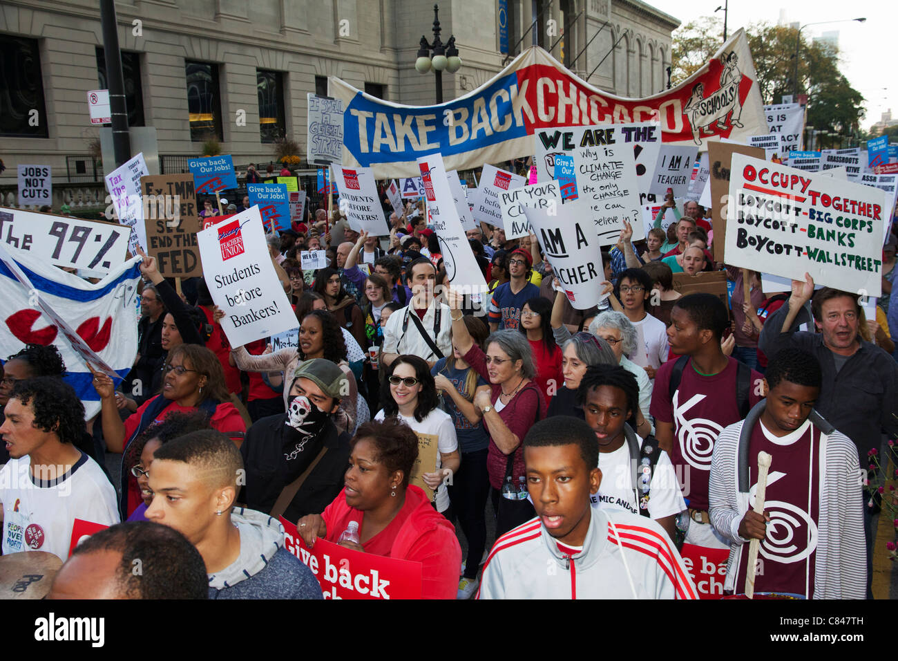 Protesters marching on Michigan Avenue. Occupy Chicago protest. - Stock Image