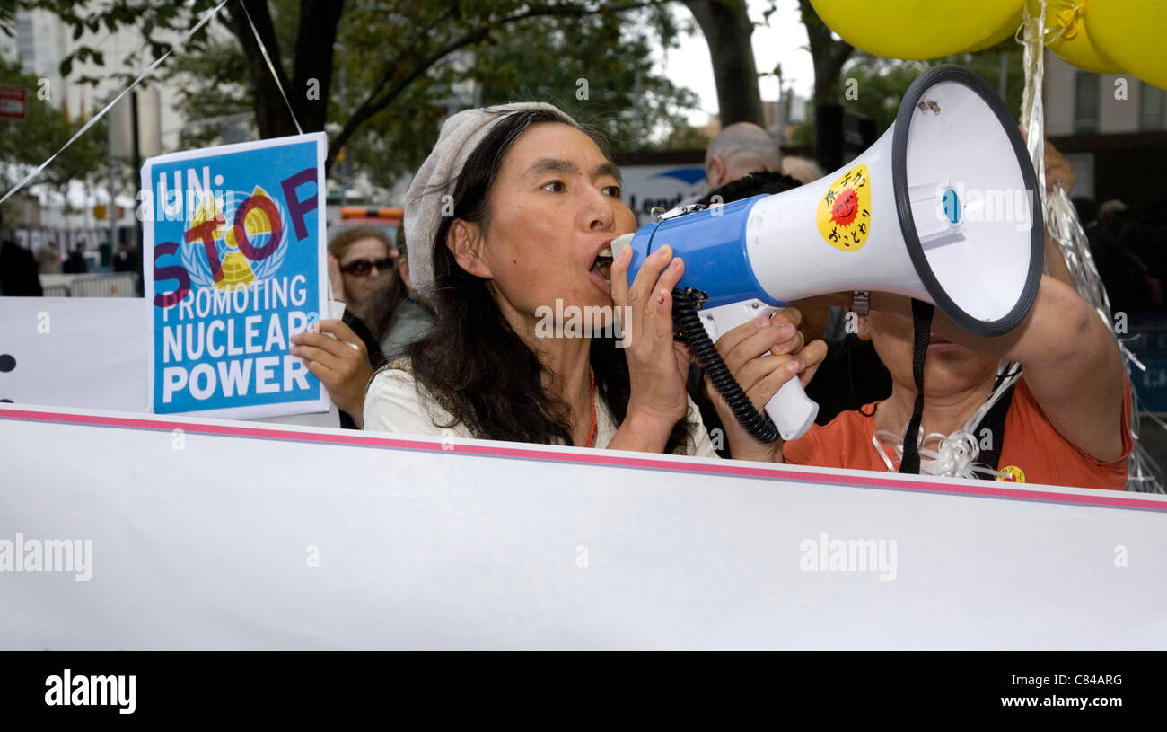 Japanese from Fukushima with other antinuke activists demonstrate outside the United Nations in NYC - Stock Image