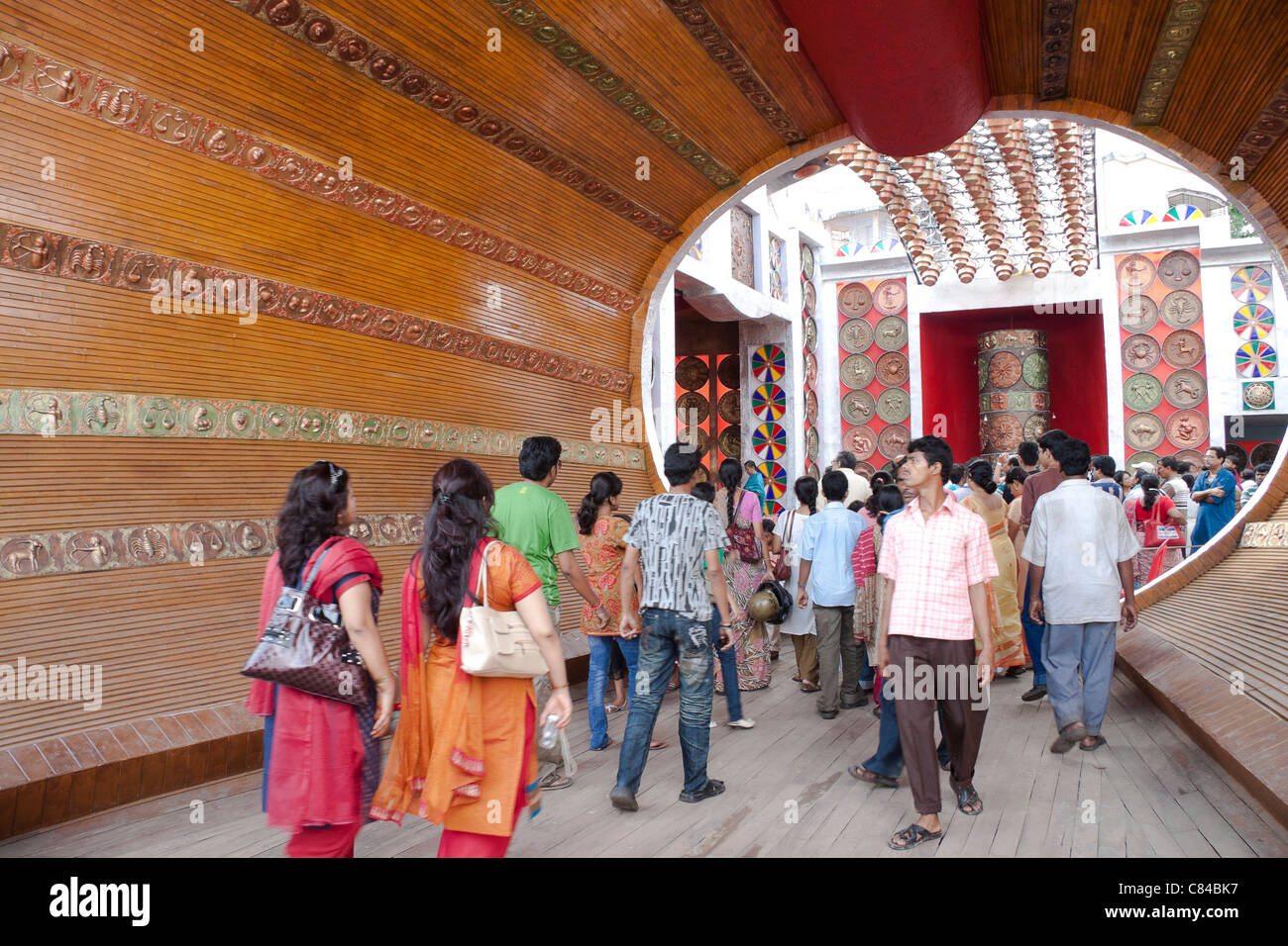 Grand wooden entry at 'Bose Pukur Durga Puja pandal' in Kasba, Kolkata (Calcutta), West Bengal, India. - Stock Image