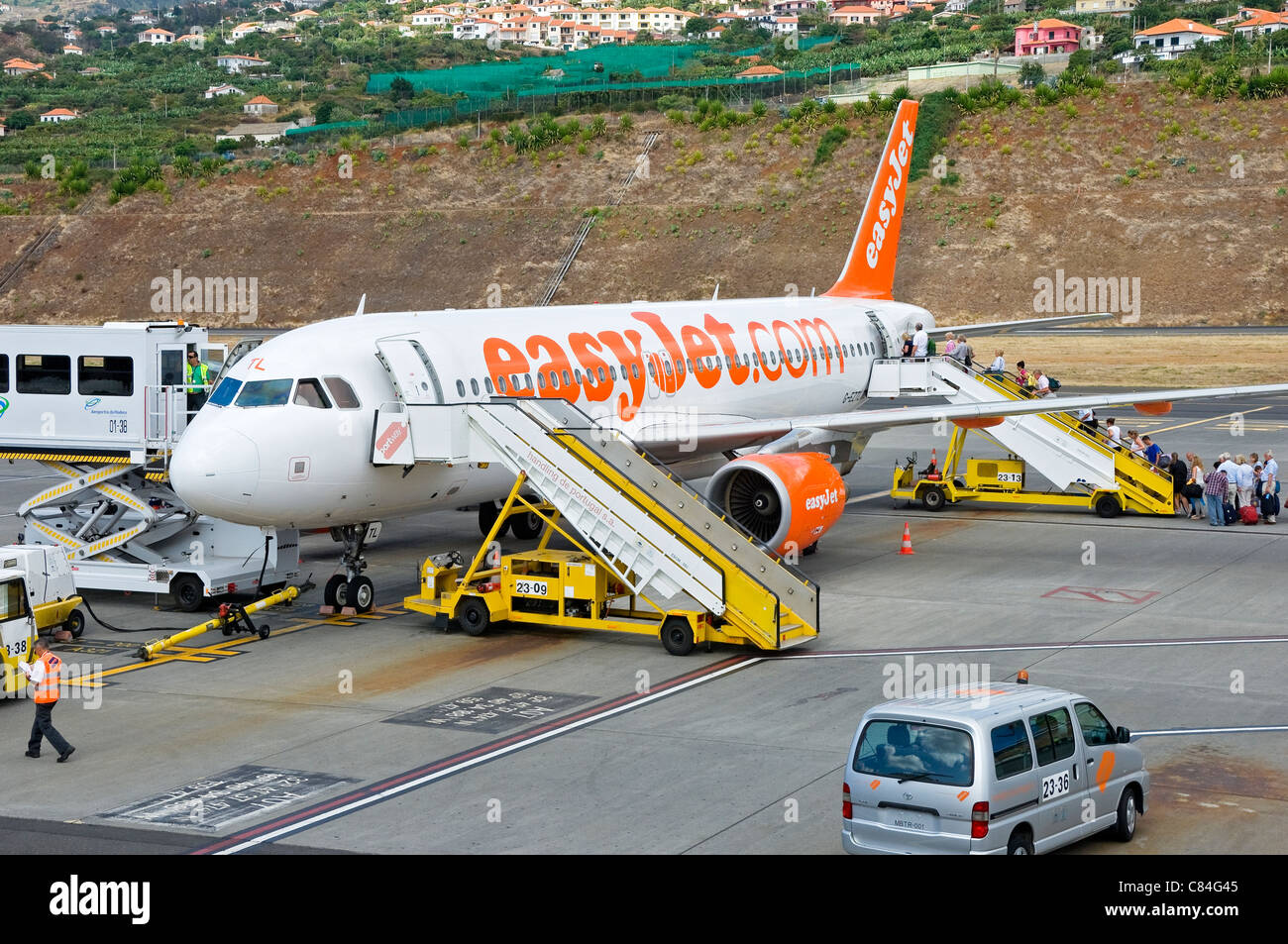 Passengers boarding EasyJet plane at Funchal airport Madeira Portugal EU Europe - Stock Image