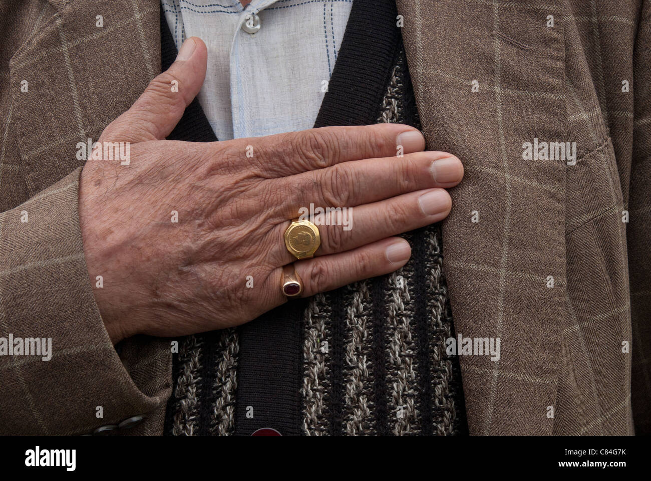 MAN HOLDING HIS HAND ON HIS CHEST,CLOSE UP SHOOT - Stock Image