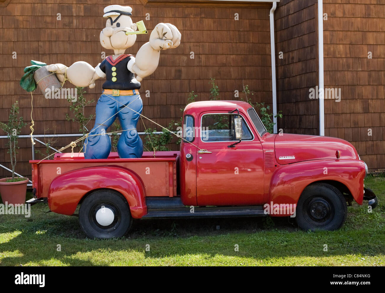 Popeye statue, pickup truck, near Riverhead, North Fork, Long Island, New York - Stock Image