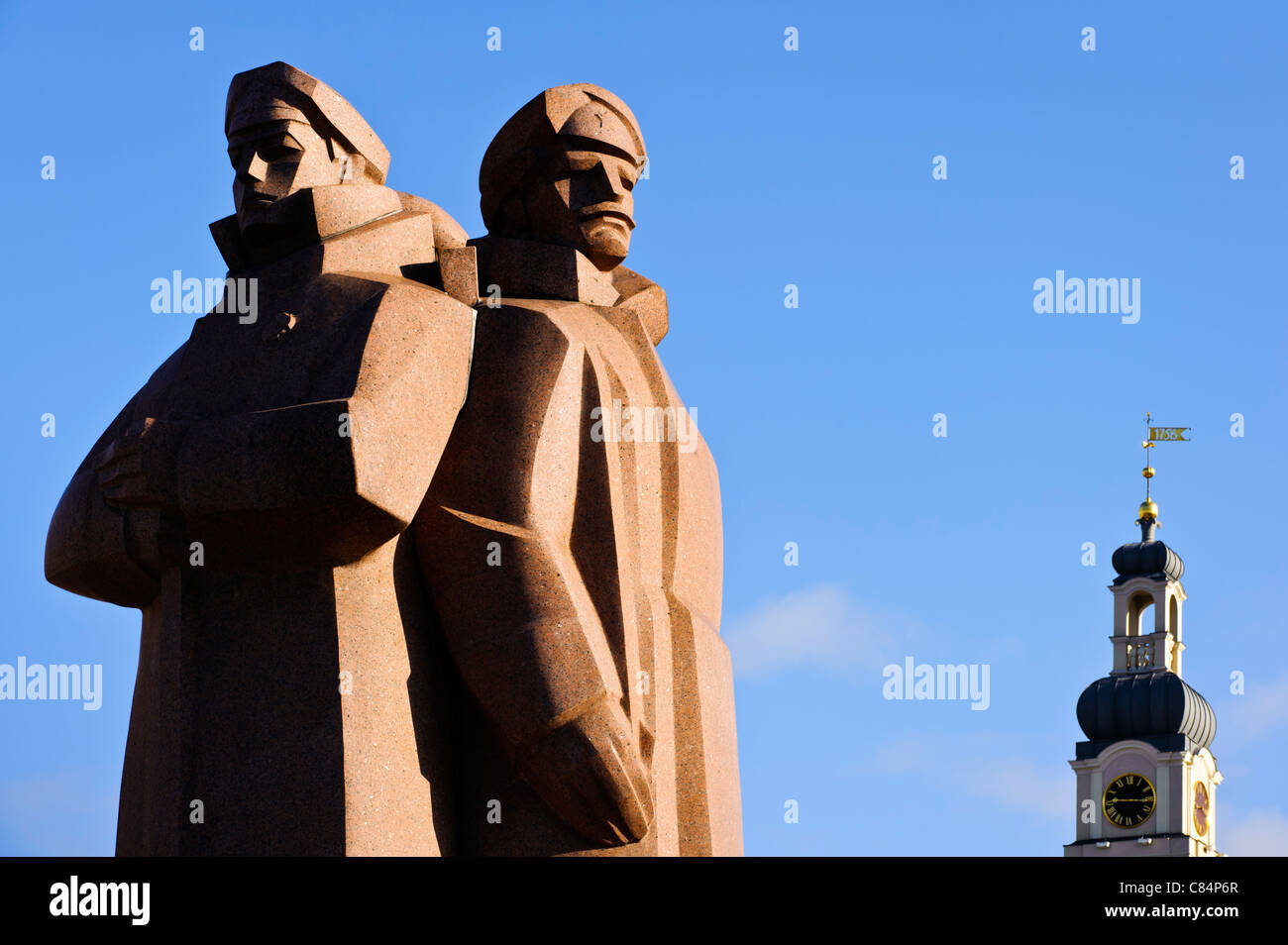 Riga. Latvian Riflemen statue & Town Hall tower. - Stock Image