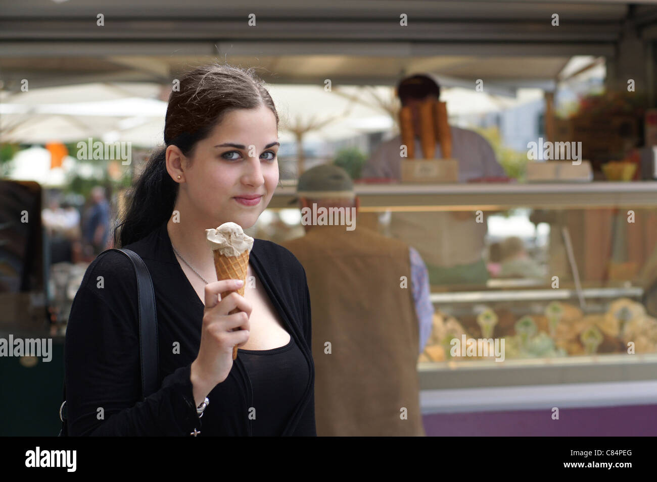 young girl in front of ice cream parlour Stock Photo
