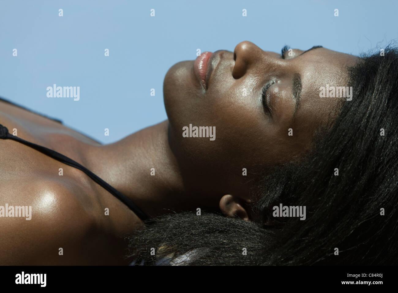 Woman sunbathing - Stock Image