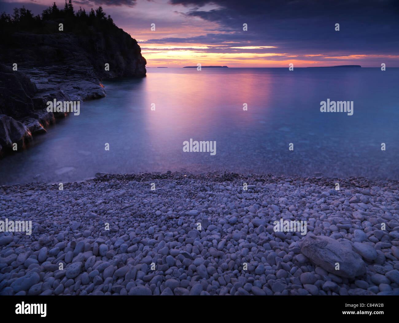 Beautiful sunset scenery of Georgian Bay rocky shore. Bruce Peninsula National Park, Ontario, Canada. - Stock Image