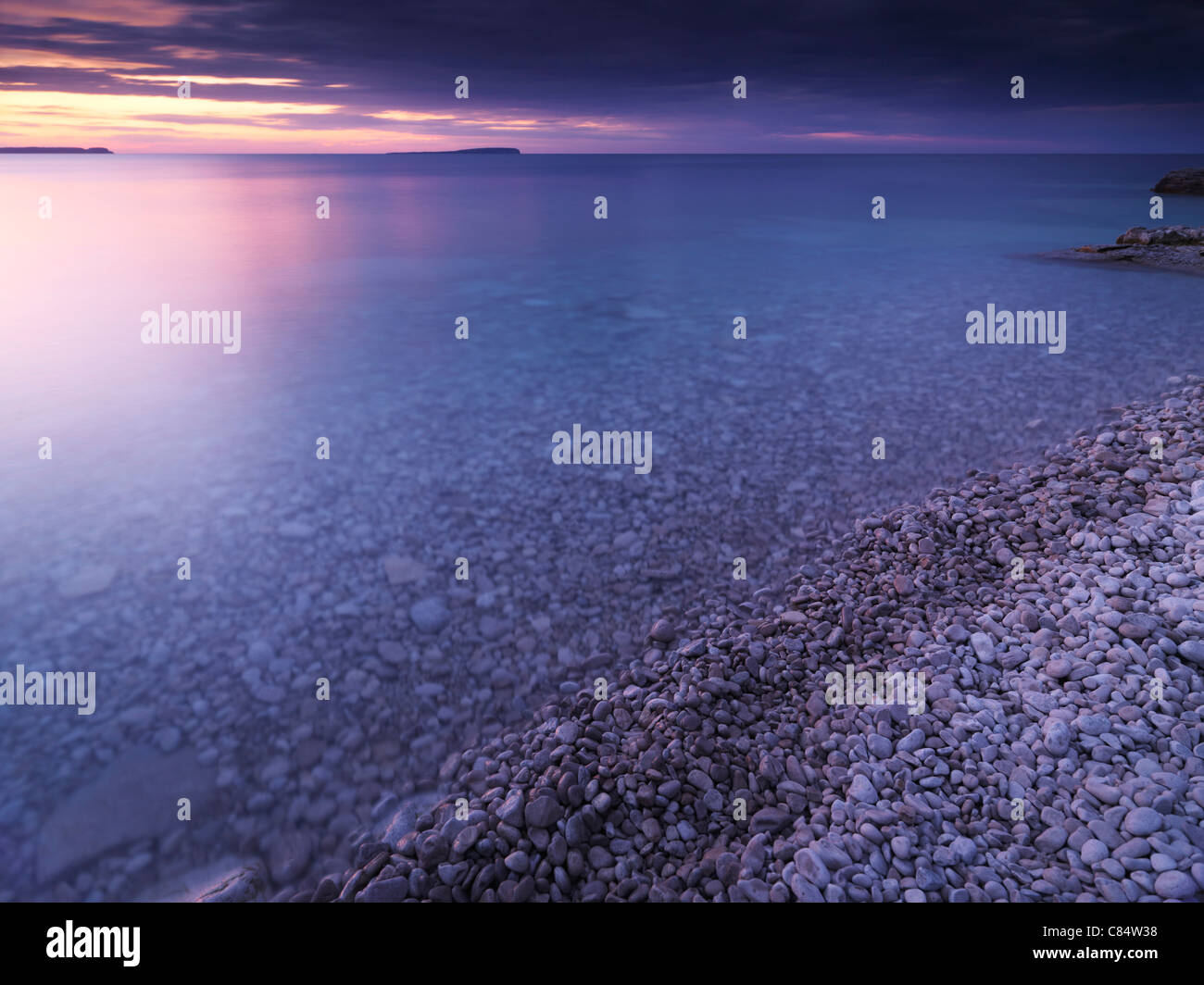 Beautiful sunset scenery of Georgian Bay pebble shore. Bruce Peninsula National Park, Ontario, Canada. Stock Photo