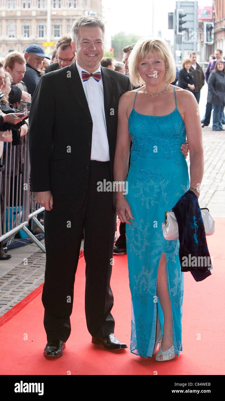 Welsh weather presenter Derek Brockway and his wife attend a black tie function. - Stock Image