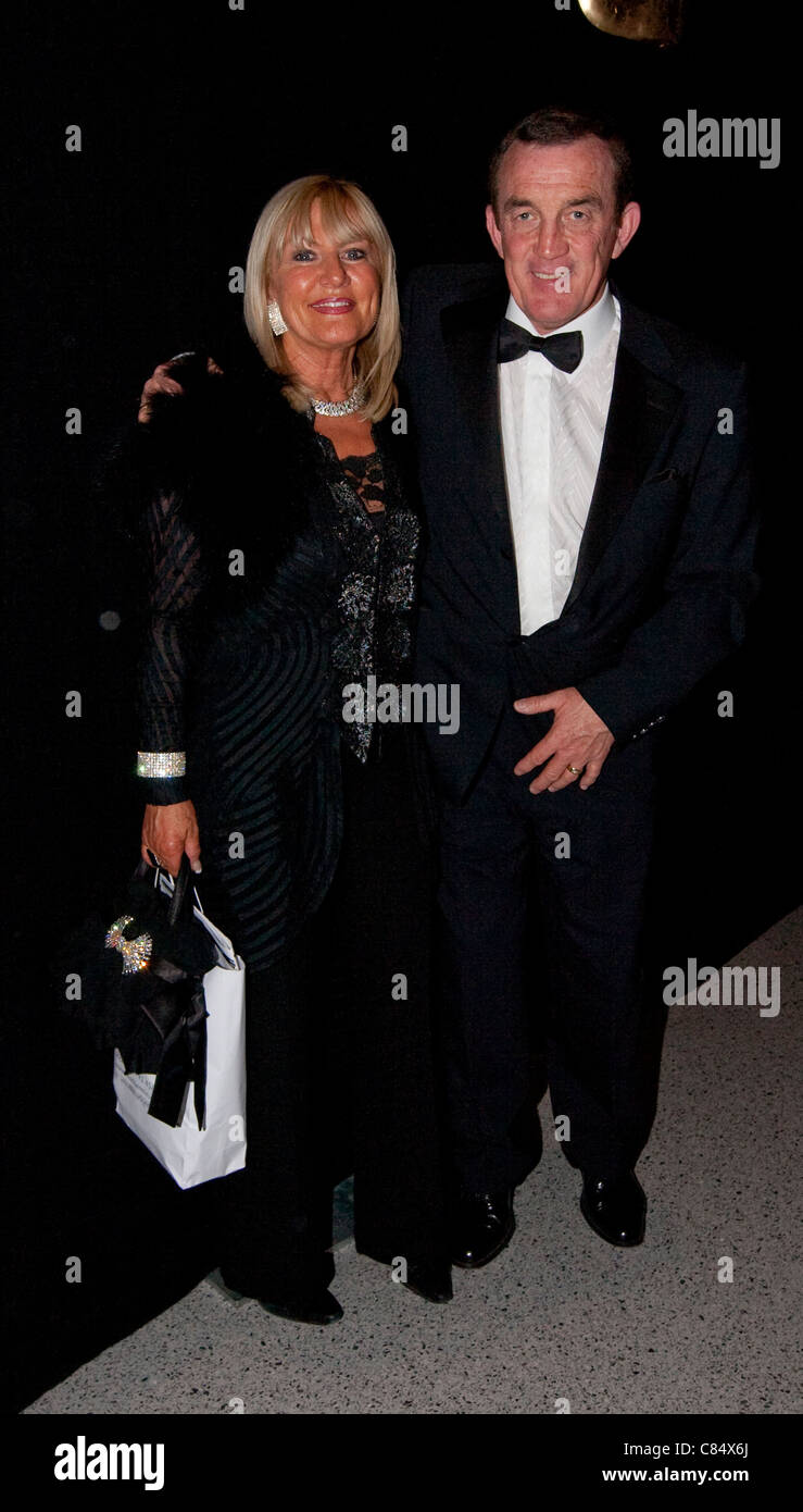 Former Welsh Rugby International Phil Bennett attending a black tie dinner with his wife. - Stock Image