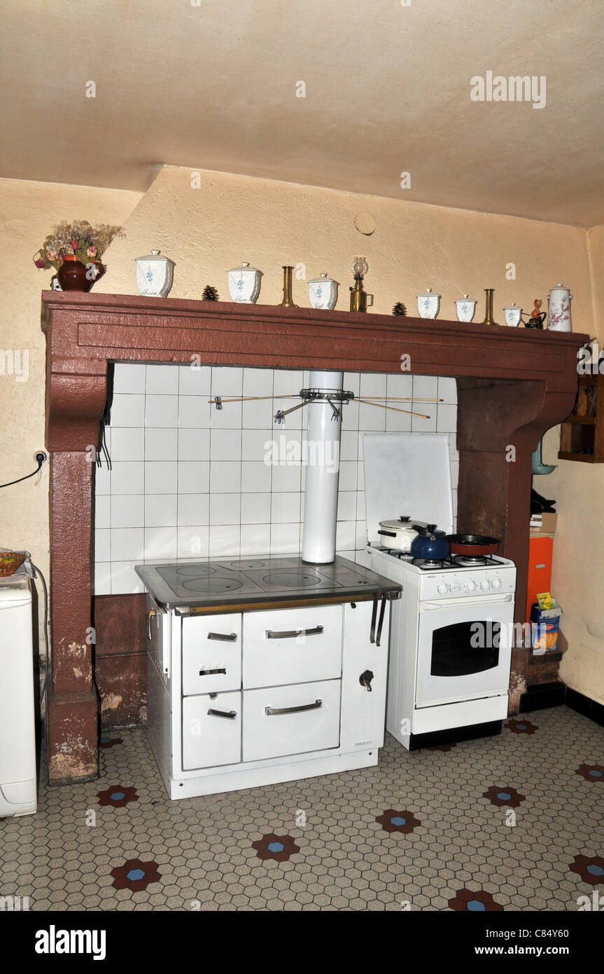 old kitchen with furnace and stove in a french farm Auvergne France - Stock Image
