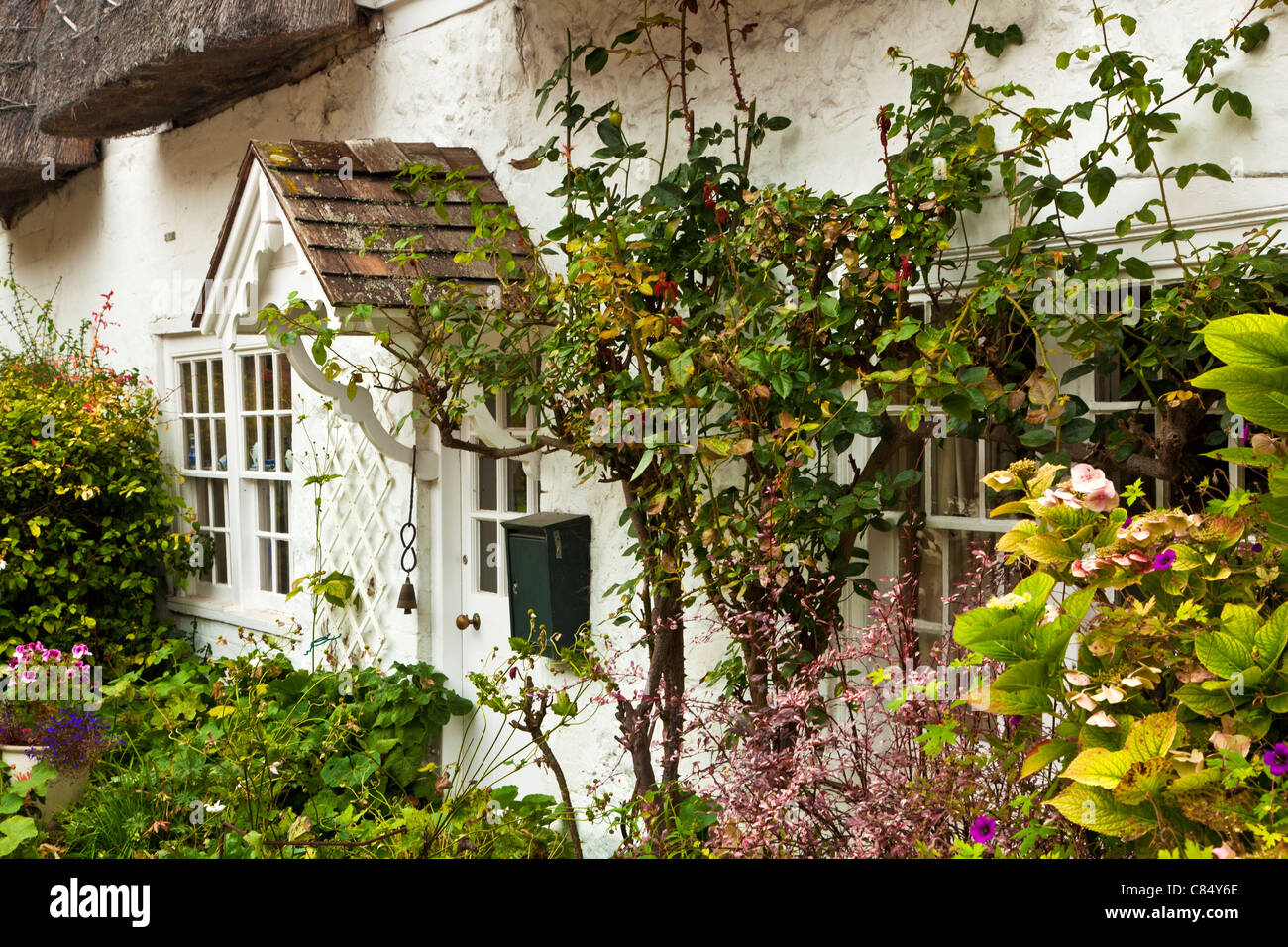Typical English country village cottage in late autumn in Avebury, Wiltshire, England, UK - Stock Image