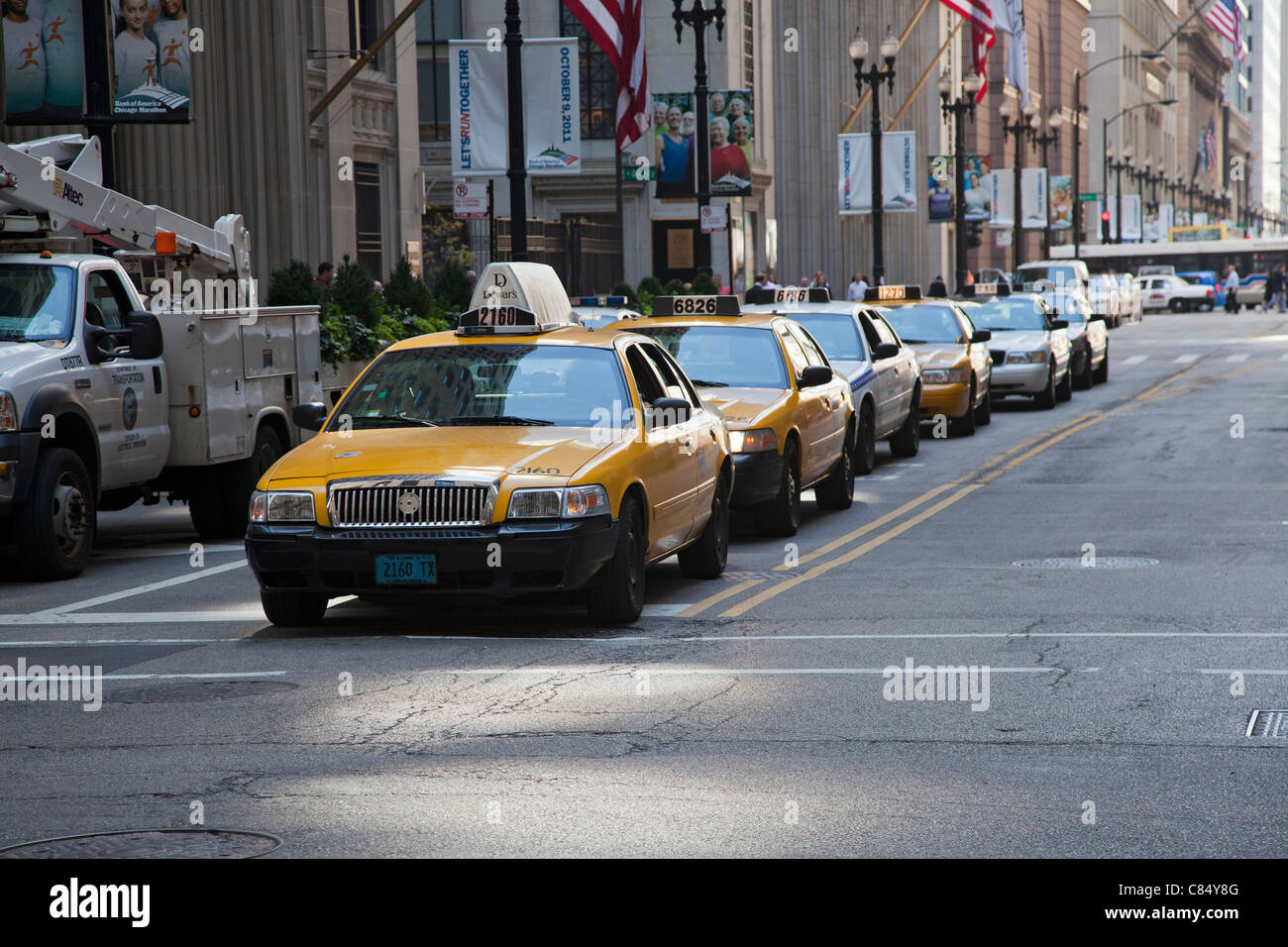 Chicago, Illinois - Taxicabs on LaSalle Street in the financial district. - Stock Image