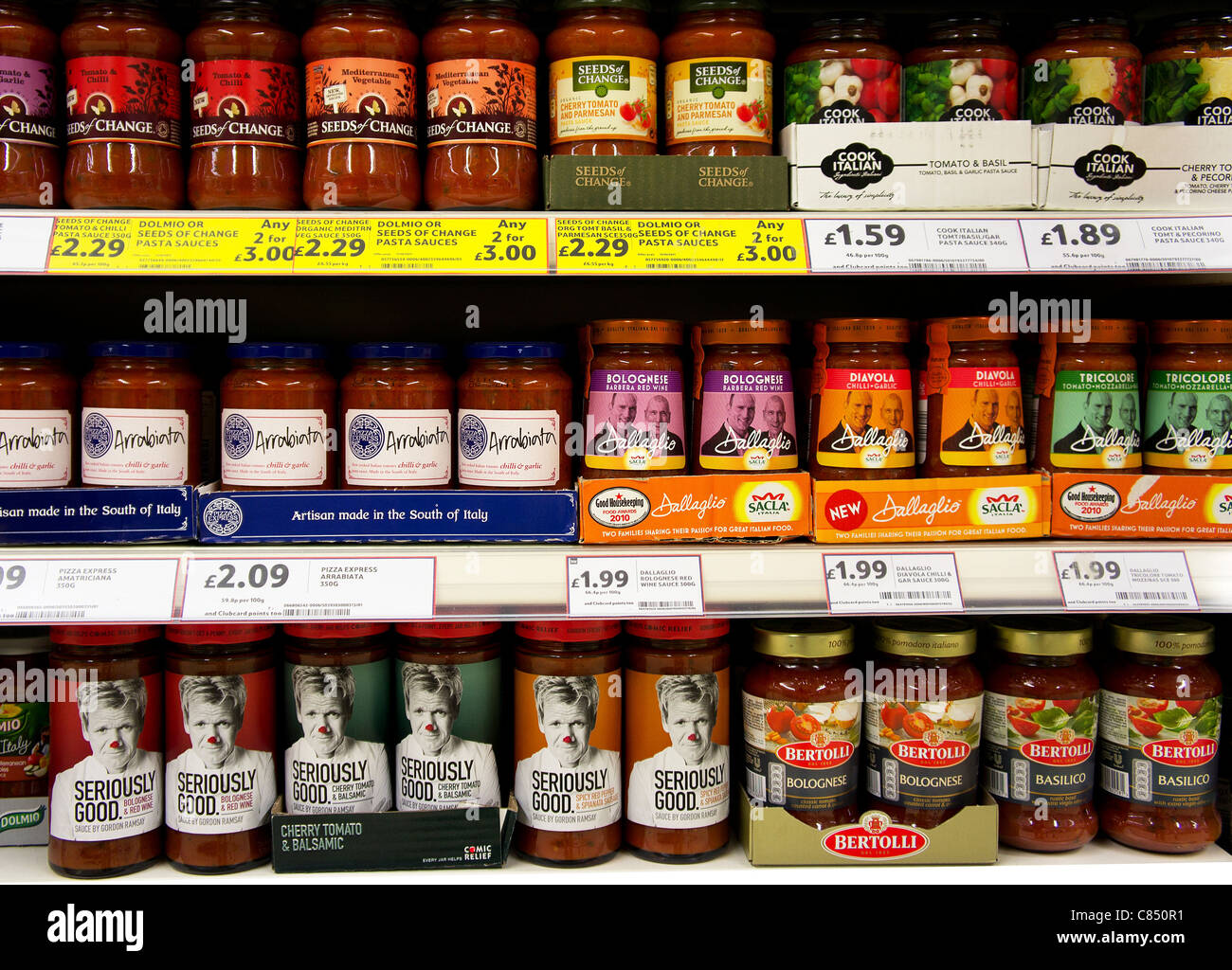 Jars of different brands of pasta sauce - Stock Image