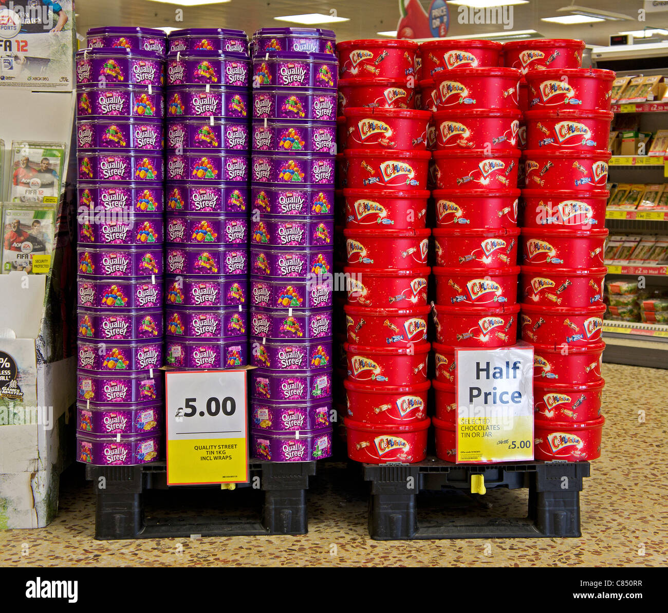 Tins of christmas sweets for sale in a tesco supermarket, uk - Stock Image